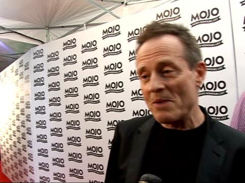 mojo awards 2008 ceremony: celebrity photocalls and interviews; john paul jones speaking to reporter john paul jones interview sot - on rumours of... - ポピュラーミュージックツアー点の映像素材/bロール
