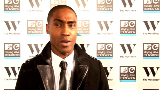 staying alive' charity event; simon webbe interview sot - why he is at event / on blue - actual reunion might not happen as they are so busy lemar... - リズ・マクラーノン点の映像素材/bロール