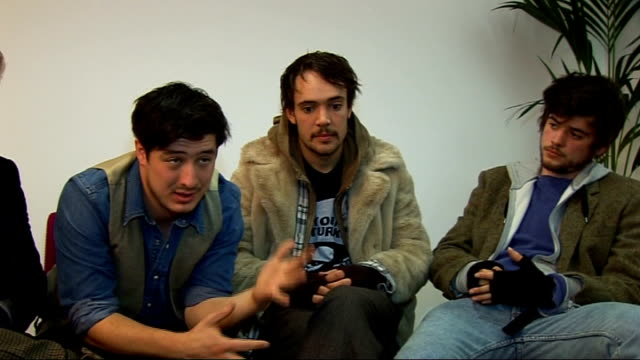 mumford and sons interview; england: london: int members of mumford and sons interviewed sot - on the outdoor gig selling out in 2 minutes - but it's... - video collage video stock e b–roll