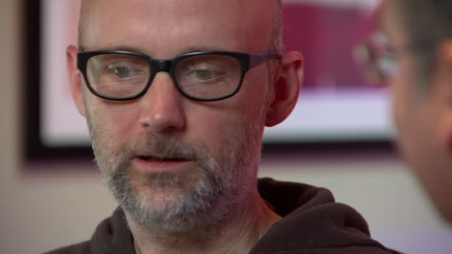 musician, producer and dj moby talks about his life after writing memoir; moby set up shots and interview in music studio sot with krishnan guru... - モービー点の映像素材/bロール