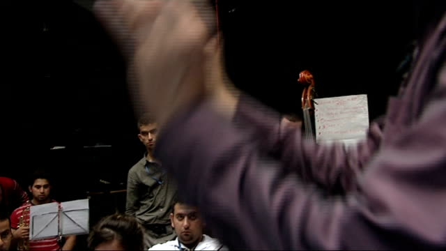 national youth orchestra of iraq perform in edinburgh bashdar ahmad interview sot general views of members of national youth orchetra of iraq playing... - stilts stock videos and b-roll footage