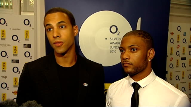nordoff robbins silver clef awards: backstage interviews; jls members photocall, talking to press and interview sot - boy band stock videos & royalty-free footage