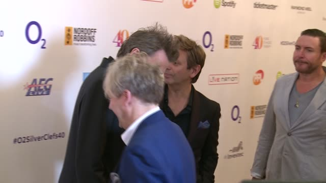 stockvideo's en b-roll-footage met o2 silver clef awards gvs james bay and peter andre / signage / gvs duran duran posing for photocall and interview sot - duran duran