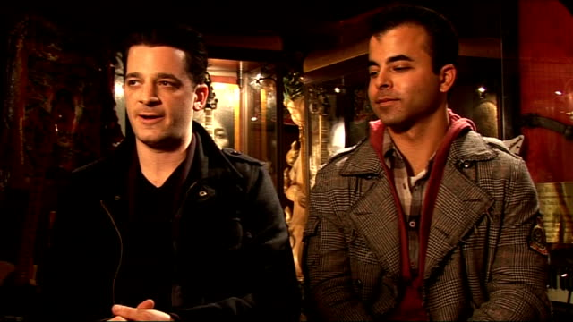 oar interview talks of latest record releases christmas tree outside the hard rock cafe and campaign poster / hard rock logo over menu - hard rock cafe stock videos & royalty-free footage
