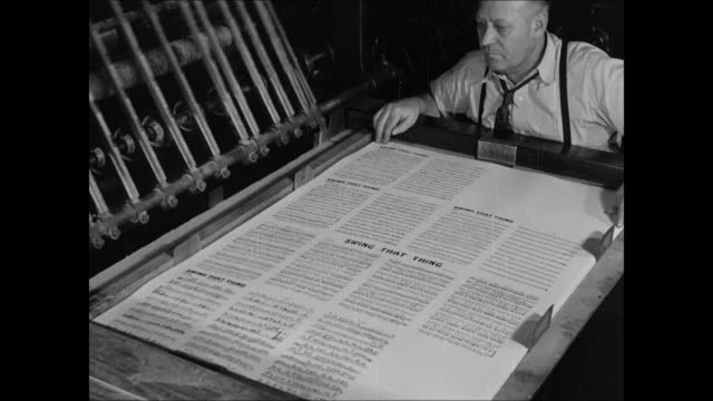 music office building display of sheet music men working at desk writers working at piano amp desk cu 'swing it baby' music being written publisher... - 1937 stock videos and b-roll footage