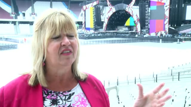 olympic stadium to host ac/dc concert general view ac/dc stage under construction linda lennon interview sot various shots olympic stadium seating... - itv london tonight weekend点の映像素材/bロール