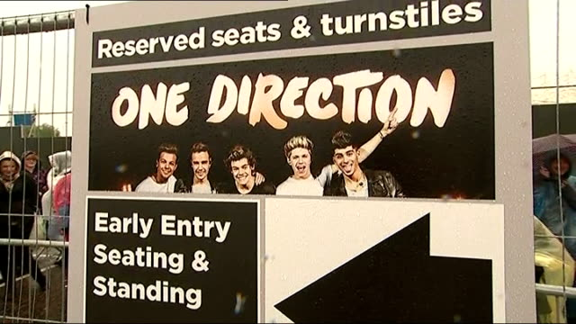 one direction alleged 'drugs' video emerges england sunderland ext one direction fans in raincoats outside venue as sing one direction song sot fans... - boy band stock videos & royalty-free footage