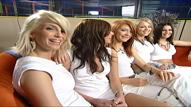 'one true voice' and 'girls aloud' interviews; england: london: int members of girl band 'girls aloud' sitting on sofa as call out their names and... - sofa stock videos & royalty-free footage