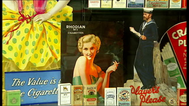 music overlaid - johnny cash - 'ring of fire' sot ** various shots of vintage cigarette packets on display in museum of brands ends - johnny cash stock videos & royalty-free footage