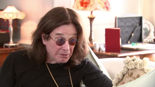 ozzy osbourne interview england int ozzy osbourne interview sot ageing process / 70th birthday cutaways two shots with reporter - ozzy osbourne stock videos & royalty-free footage