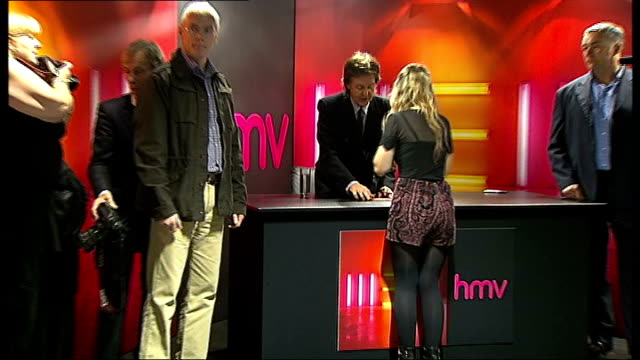 Paul McCartney interview and popup performance **Music heard SOT** Fans queuing up in HMV / McCartney arriving and speaking to fans SOT / McCartney...