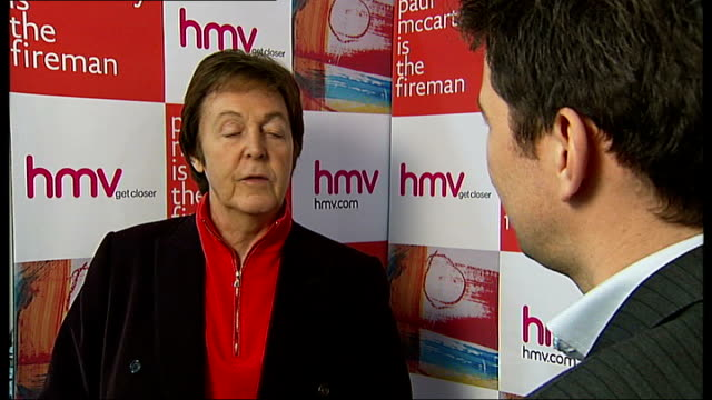 paul mccartney meets fans at 'the fireman' album signing sir paul mccartney interview sot on experimental music / likes hiding behind a pseudonym... - アルバムのタイトル点の映像素材/bロール