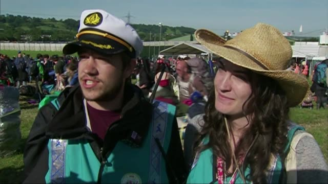 People arrive for Glastonbury Festival ENGLAND Somerset Glastonbury EXT Countdown 2 1 SOT Gates opened and people arrive at festival Vox Pops Various...