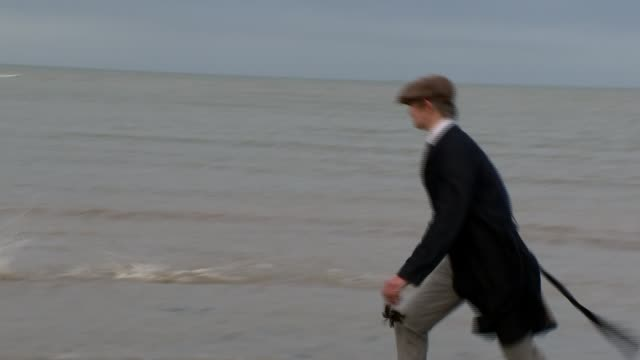 pete doherty interview uk kent margate pete doherty walking dogs along the beach by the sea throwing stones reciting poetry singing playing guitar... - whistling stock videos & royalty-free footage
