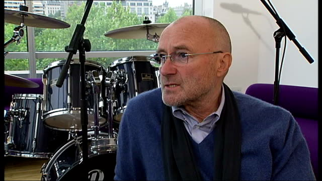 phil collins interview; england: london: int phil collins interview with reporter in shot sot - jokes about the reporter being a fan / on being born... - phil collins stock videos & royalty-free footage