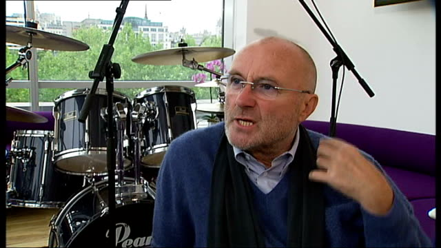 phil collins interview; phil collins interview sot - on not being able to drum anymore due to medical problems / the gorilla commercial for cadbury's... - phil collins stock videos & royalty-free footage