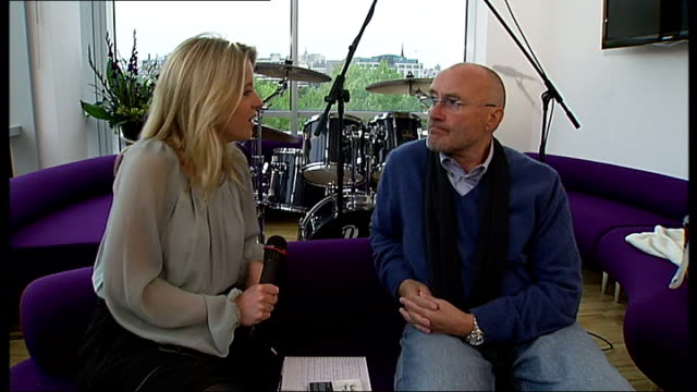 phil collins releases new record; england: london: int reporter telling phil collins what a big fan she is sot - phil collins stock videos & royalty-free footage