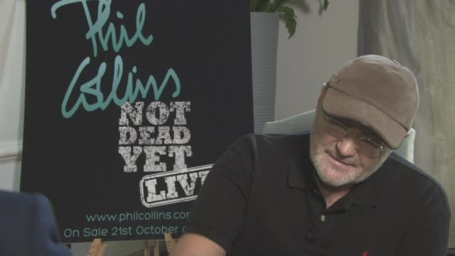 phil collins to come out of retirement after ten years; phil collins interview sot cutaway reporter - phil collins stock videos & royalty-free footage