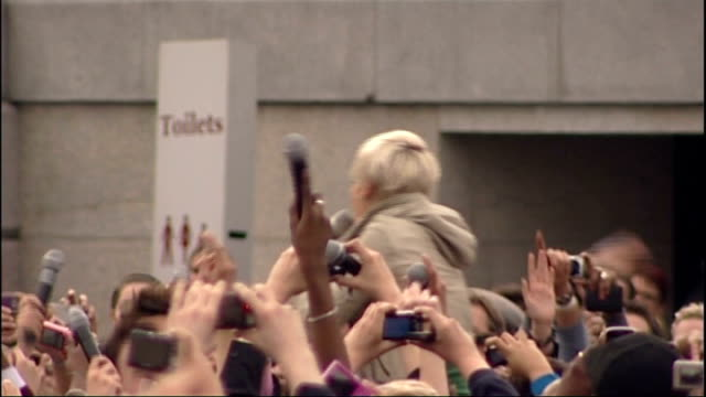 pink interview england london ext various views of pink singing 'so what' along with a crowd in trafalgar square as part of mobile phone... - pink singer stock videos and b-roll footage