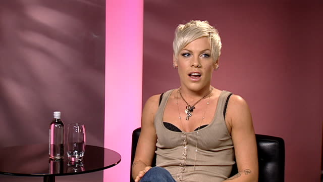pink interview england london int pink interview sot on performing in trafalgar square shooting an advert for tmobile karaoke / on tour in the uk... - popular music tour stock videos and b-roll footage