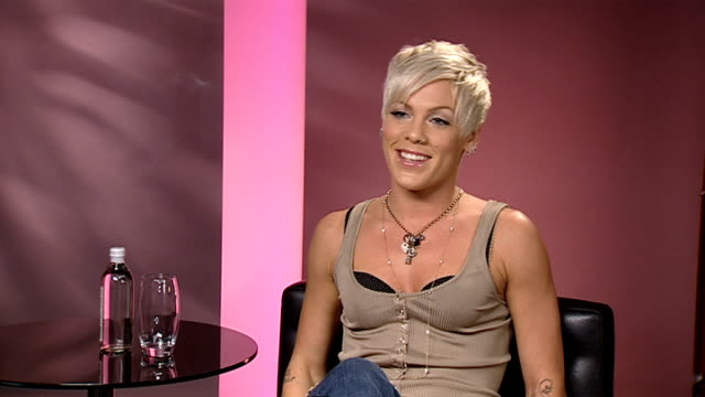 pink interview int pink interview sot on enjoying singing karaoke version of 'so what' in trafalgar square with crowd - pink singer stock videos and b-roll footage