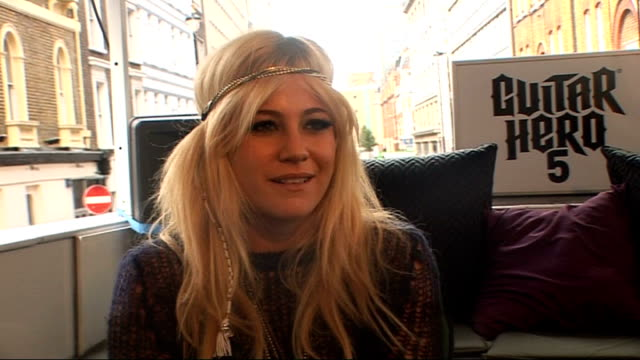 Pixie Lott at launch of 'Guitar Hero 5' Pixie Lott interview SOT Enjoyed playing Guitar Hero 5 / playing computer games / whether her single could...