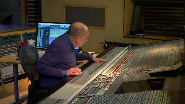 profile of gary langan producer of queen **music heard 'bohemian rhapsody' by queen** hands sliding knob up on sound board various shots of gary... - switch stock videos & royalty-free footage