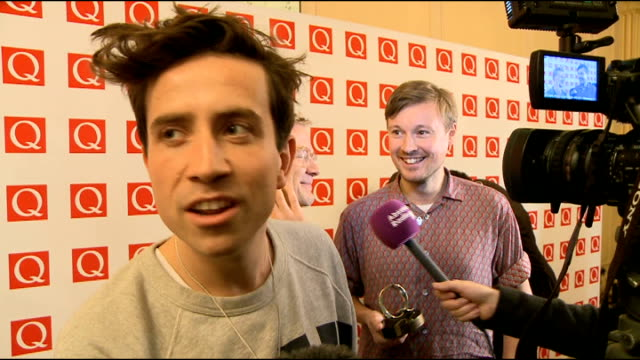 q awards 2012 red carpet arrivals post show red carpet int unidentified woman posing / nick grimshaw posing nick grimshaw interview sot shingai... - tim rice stock videos & royalty-free footage