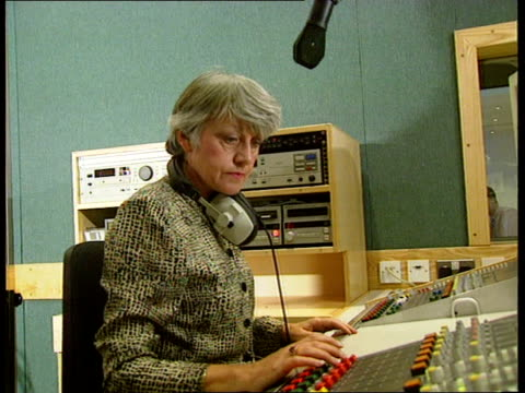 'Classic FM ' station launch preview bNAO ENGLAND London Camden Town INT Female disc jockey in Classic FM studio ZOOM Dial registers output on...