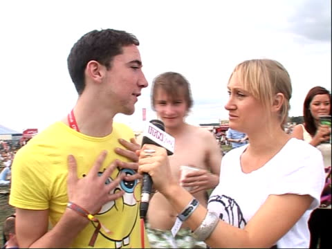 reading festival 2008: band interviews; vox pops music fans music fan performs kicking and jumping tricks - reading and leeds festivals stock videos & royalty-free footage