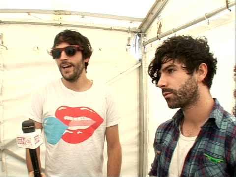 reading festival 2008 band interviews yannis philippakis and jimmy smith interview sot on wearing fancy dress at bestival / on their new album / on... - reading and leeds festivals stock videos & royalty-free footage