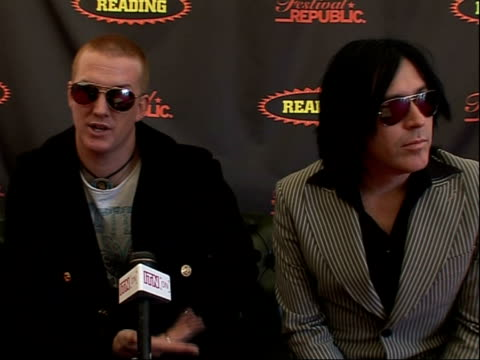 reading festival 2008: interviews with bands; josh homme and troy van leeuwen interview sot - on performing at reading music festival / on their best... - reading and leeds festivals stock videos & royalty-free footage