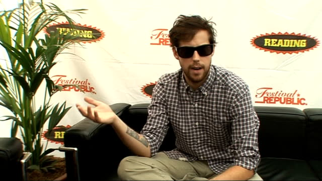 reading festival 2009: andrew mcmahon interview; mcmahon interview sot - loves the community feel of festival / the diversity of the reading line-up... - reading and leeds festivals stock videos & royalty-free footage