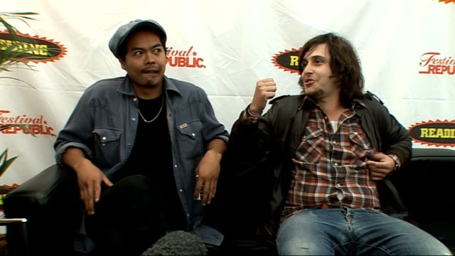 reading festival 2009: the temper trap interview; england: berkshire: reading: int from left-right dougie mandagi and lorenzo sillitto interview sot... - arcade fire stock videos & royalty-free footage