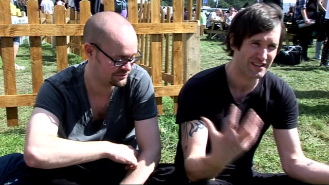 reading festival 2010 interviews ash interview sot no immediate plans for future bringing out all the singles has been tough / on whether they're... - reading and leeds festivals stock videos and b-roll footage