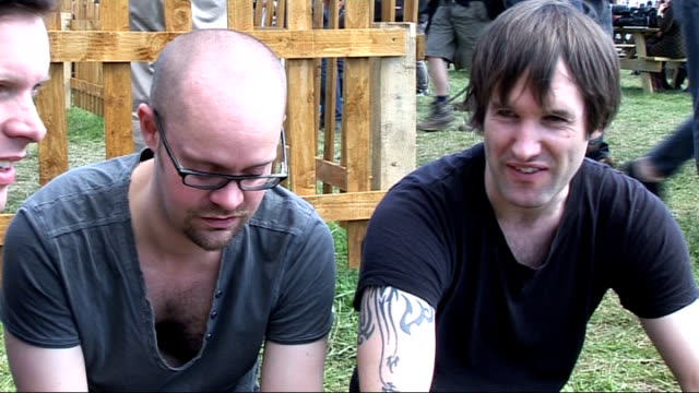 reading festival 2010 interviews ash interview sot what else they want to see / about libertines gig don't have much good to say about them they talk... - reading and leeds festivals stock videos & royalty-free footage