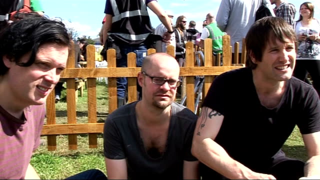 reading festival 2010 interviews; england: berkshire: reading: ext ash interview sot - heard only bad things about the weather so far / on their... - arcade fire stock videos & royalty-free footage