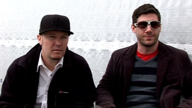 reading festival 2010 interviews; ext fred durst and wes borland interview sot - explain what's in fred's drink / how it feels to be back - say... - nu stock videos & royalty-free footage