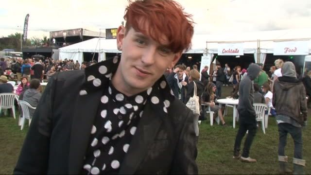 vídeos y material grabado en eventos de stock de reading festival 2011: celebrity interviews; patrick wolf interview sot - on who he's excited to see / festival fashion / music and fashion / style... - reading and leeds festivals