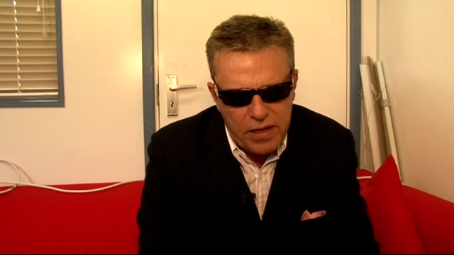 reading festival 2011 celebrity interviews suggs interview continues sot on meeting young artists / whether he's an xfactor fan / manufactured music... - reading and leeds festivals stock videos & royalty-free footage