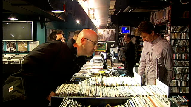 record store day: celebrations in soho; int phil barton interview sot - people come in to browse, find new things, meet people - record shops will... - itv london tonight weekend stock-videos und b-roll-filmmaterial