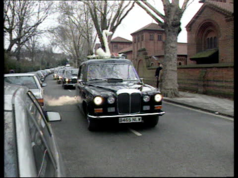 north london: golders green: funeral cortege towards cms denis norden outside church crowds outside church l-r tx 7.1.97/nat - denis norden stock videos & royalty-free footage