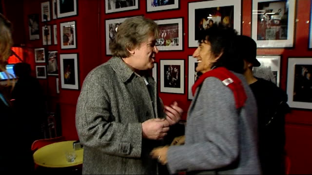 ronnie wood interview england london oxford street 100 club photography *** ronnie wood speaking with mick taylor as surrounded by press sot talk... - hatfield stock videos and b-roll footage