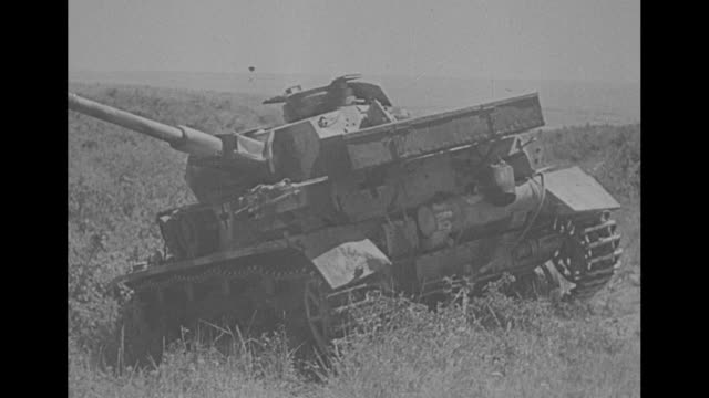 music, russian language narration at various points] vs buildings burn at night as soldiers run past during battle of the river don / day: tanks and... - armored tank stock videos & royalty-free footage
