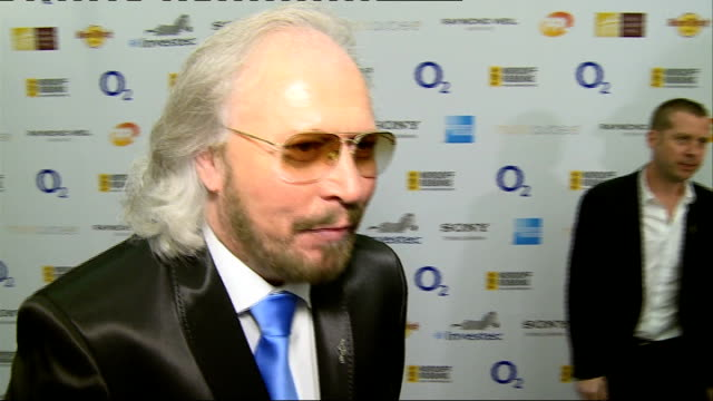 Silver Clef awards Red Carpet Interviews ENGLAND London Hilton PHOTOGRAPHY** James Anderson interview SOT Barry Gibb posing with award Barry Gibb...
