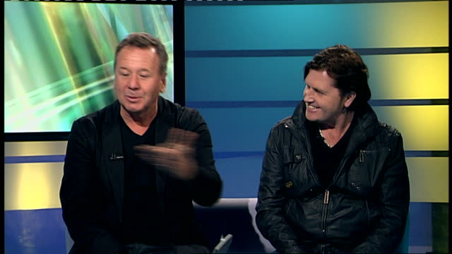 vídeos de stock, filmes e b-roll de simple minds' jim kerr and charlie burchill interview england london gir int simple minds' band members jim kerr and charlie burchill interview sot... - título de álbum