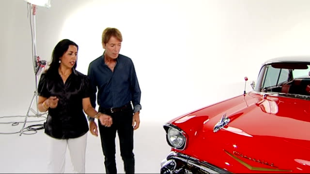 sir cliff richard celebrates one hundredth album release reporter walking around in studio with cliff and looking at red car sir cliff richard... - アルバムのタイトル点の映像素材/bロール