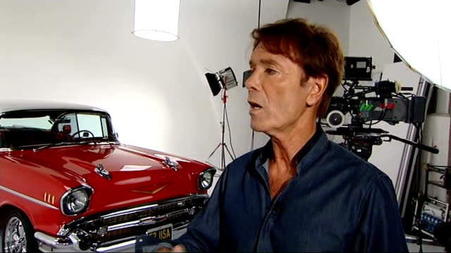 sir cliff richard celebrates one hundredth album release england london int reporter introduction sir cliff richard interview sot reporter to camera - アルバムのタイトル点の映像素材/bロール