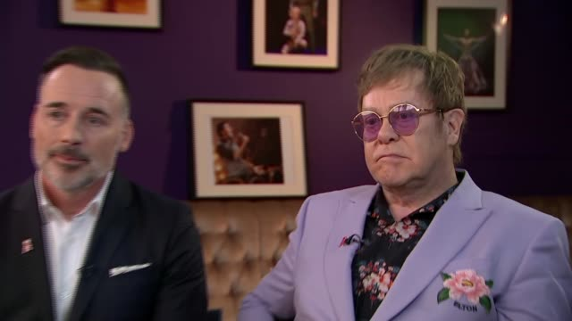 sir elton john and david furnish interview netherlands amsterdam int sir elton john david furnish interview sot on working at a grassroots level on... - elton john stock videos & royalty-free footage
