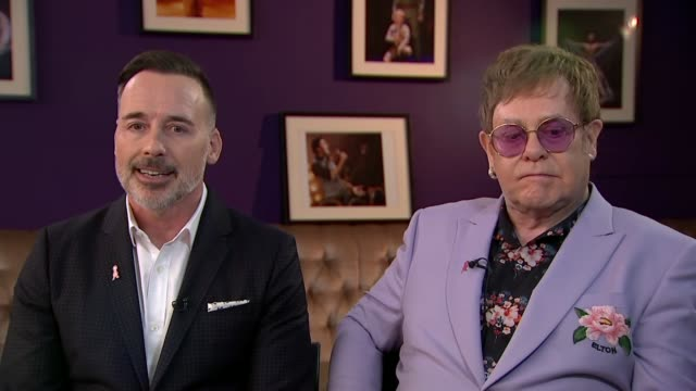 sir elton john and david furnish interview netherlands amsterdam int sir elton john david furnish interview sot on the fight against hiv and aids /... - elton john stock videos & royalty-free footage